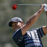 Tiger Woods of the U.S. hits from the 12th fairway during first round play in the 2013 WGC-Cadillac Championship PGA golf tournament in Dora