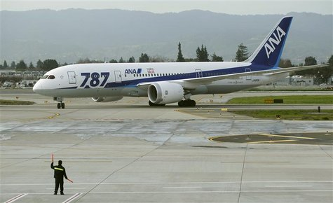 An All Nippon Airways Boeing 787 Dreamliner passenger jet is directed to its gate after arriving from Tokyo at San Jose International Airpor
