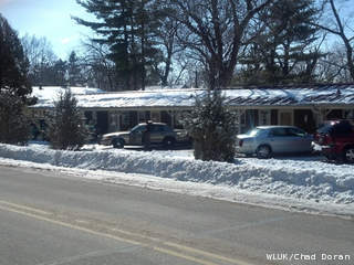 Waushara Co. sheriff's deputies investigate a suspicious death at the Mt. Morris Motel in the town of Mt. Morris March 7, 2013. (courtesy of FOX 11).