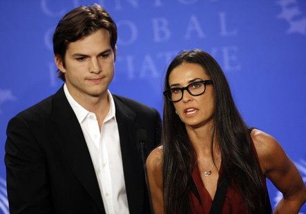 "Actors Ashton Kutcher (L) and Demi Moore announce the launch of their ""Real Men"" campaign at a news conference during the Clinton Global Ini"