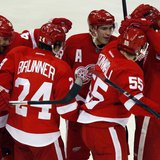 Detroit Red Wings players celebrate with teammate Niklas Kronwall (2nd R) after he scored the game winning goal against Edmonton Oilers goal