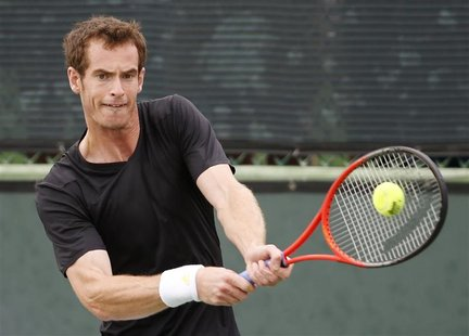 Andy Murray of Britain hits the ball while practicing at the BNP Paribas Open ATP tennis tournament in Indian Wells, California, March 7, 20