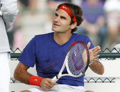 Roger Federer of Switzerland talks with coach Paul Annacone during practice at the BNP Paribas Open ATP tennis tournament in Indian Wells, C