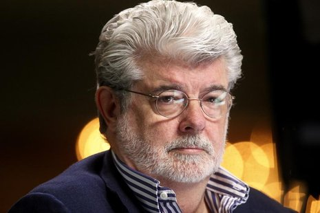 Filmmaker and Chairman of the Board of Lucasfilm Ltd. George Lucas waits to do a television interview at the Milken Institute Global Confere