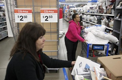 Shoppers make their way past an endcap that once held discounted pillows at a Walmart Store in Chicago, November 23, 2012. REUTERS/John Gres