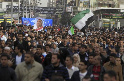People against Egyptian President Mohamed Mursi attend the funeral of Ahmed Galal, who died during clashes between police and demonstrators,