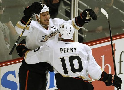 Anaheim Ducks' Ryan Getzlaf (L) celebrates his goal against the Chicago Blackhawks with teammate Corey Perry during the second period of the