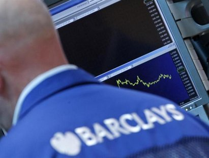 A Barclay's trader works on the floor of the New York Stock Exchange, July 3, 2012. REUTERS/Brendan McDermid