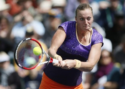 Petra Kvitova of the Czech Republic returns a shot against Olga Govortsova of Belarus during their match at the BNP Paribas Open WTA tennis