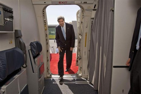 U.S. Secretary of State John Kerryn boards his aircraft to return to Washington at the airport in Doha, March 6, 2013. REUTERS/Jacquelyn Mar