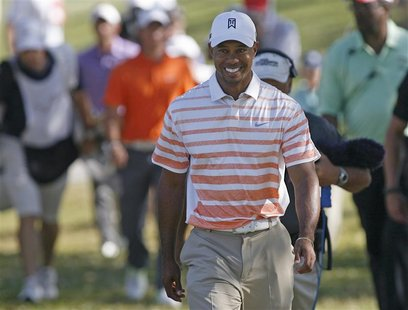 Tiger Woods of the U.S. walks to the 11th tee following a birdie during second round play in the 2013 WGC-Cadillac Championship in Doral, Fl
