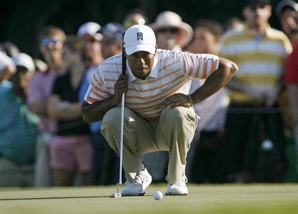 Tiger Woods of the U.S. looks at his putt on the 13th hole during second round play in the 2013 WGC-Cadillac Championship PGA golf tournamen