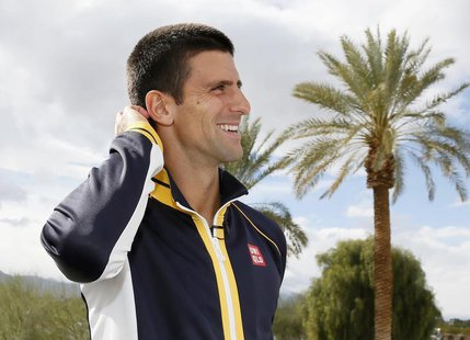 Novak Djokovic of Serbia ponders a trivia question about a fellow tennis player while he is interviewed at the BNP Paribas Open ATP tennis t