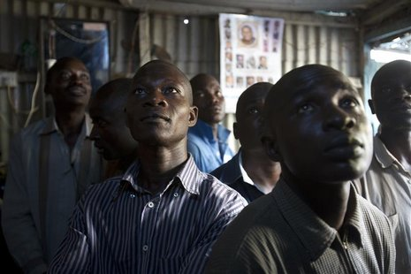 Supporters of Kenyan Prime Minister Raila Odinga watch election results on television in the Mathare slum in the Kenyan capital of Nairobi,