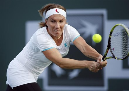 Svetlana Kuznetsova of Russia returns a shot against Jelena Jankovic of Serbia during their match at the BNP Paribas Open WTA tennis tournam