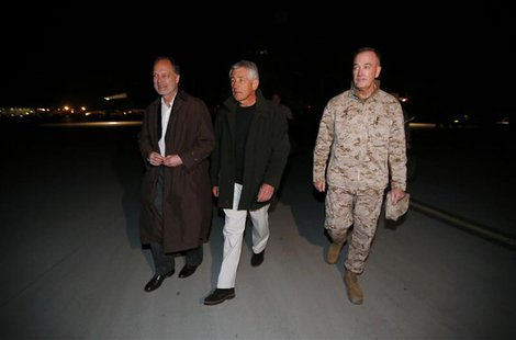 U.S. Secretary of Defense Chuck Hagel (C) walks with U.S. Ambassador to Afghanistan James Cunningham (L) and General Joseph Dunford, Command