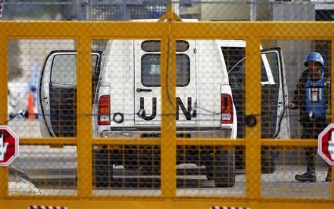 A Filipino United Nations peacekeepers enters a car at the Kuneitra border crossing between Israel and Syria, close to the ceasefire line be