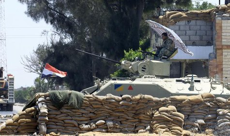 An Egyptian soldier guards a checkpoint at Rafah city, some 350 km (217 miles) northeast of Cairo August 9, 2012. REUTERS/Mohamed Abd El Gha