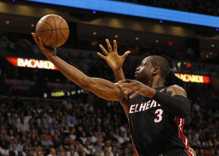 Miami Heat guard Dwyane Wade scores a basket against the Orlando Magic during their NBA basketball game at the American Airlines Arena in Mi