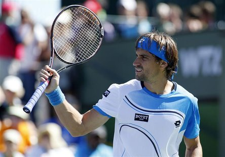 David Ferrer of Spain reacts after winning a point against Kevin Anderson of South Africa during their match at the BNP Paribas Open ATP ten