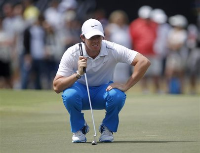 Northern Ireland's Rory McIlroy looks at his putt on the ninth green during the third round of play in the 2013 WGC-Cadillac Championship PG