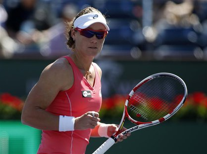 Samantha Stosur of Australia celebrates winning a point against Madison Keys of the U.S. during their match at the BNP Paribas Open WTA tenn