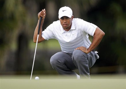 Tiger Woods lines up a putt on the 13th green during third round play in the 2013 WGC-Cadillac Championship PGA golf tournament in Doral, Fl