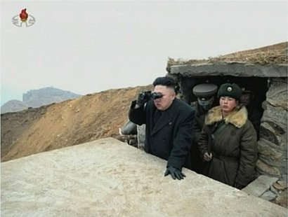 North Korean leader Kim Jong-un looks through a pair of binoculars at an undisclosed location, in this still image taken from video shown by