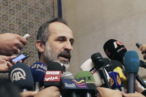 Syrian National Coalition leader Moaz Alkhatib speaks to the media after meeting with Arab League head Nabil al-Arabi in Cairo February 11,