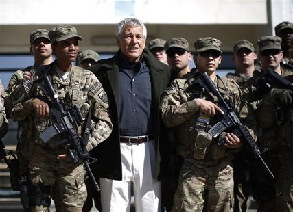 U.S. Secretary of Defense Chuck Hagel (C) poses for a picture with members of the U.S. Army and Marines during his visit to the Kabul Milita