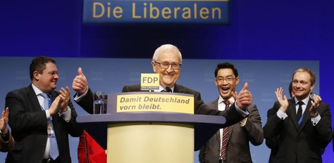 Faction leader of the liberal Free Democratic Party (FDP) Rainer Bruederle (C) reacts after his speech during a two-day party convention in