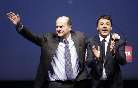 Italian PD (Democratic Party) leader Pierluigi Bersani (L) waves next to mayor of Florence Matteo Renzi during a political rally in Florence