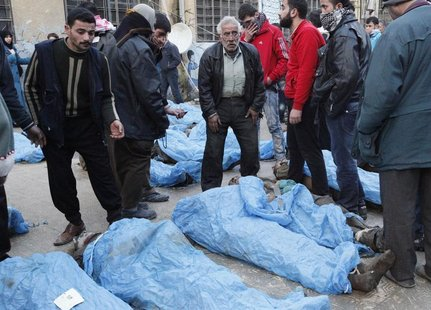 Residents attempt to identify bodies found along a river, at a school used as a field hospital in Aleppo's Bustan al-Qasr January 29, 2013.
