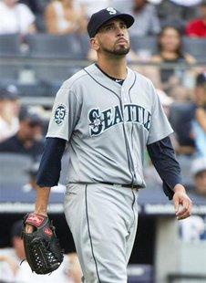 Seattle Mariners relief pitcher Oliver Perez reacts after he gave up a two-run single to New York Yankees batter Raul Ibanez in the sixth in