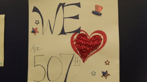 The gym was decorated with hand made signs welcoming the troops home.