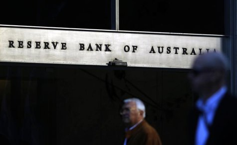 Sun reflects off the front door sign of the Reserve Bank of Australia building in Sydney in this July 5, 2011 file photo. REUTERS/Tim Wimbor