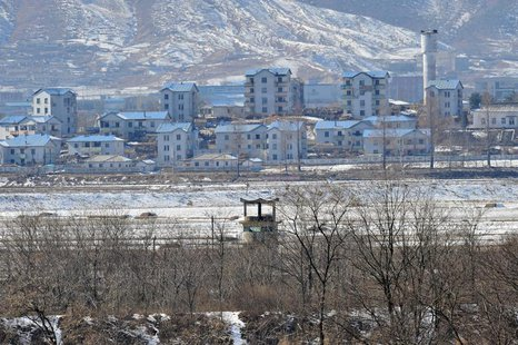 A North Korean guard post (C) in the propaganda village of Gijeongdong is seen from South Korea's Taesungdong freedom village, near the bord