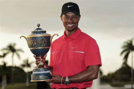 Tiger Woods poses with the Gene Sarazen Trophy after winning the 2013 WGC-Cadillac Championship PGA golf tournament in Doral, Florida March