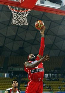 Puerto Rico's Renaldo Balkman goes for a basket against Jordan's Khaldoon Abu Ruqayah during their 2012 FIBA Olympic Qualifying Tournament i