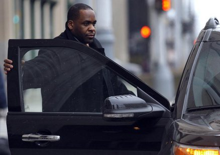 Former Detroit Mayor Kwame Kilpatrick gets into a vehicle in front of the federal courthouse during a break in the closing arguments of his