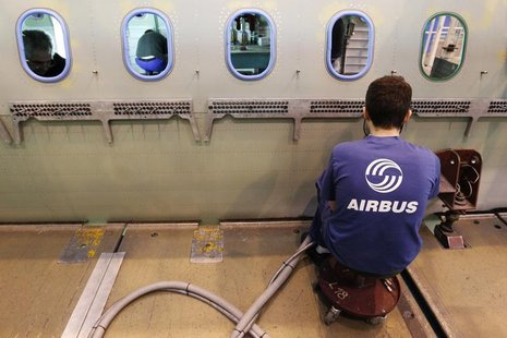 An Airbus employee works in a fuselage section of an A320 Airbus airplane at the Airbus facility in Montoir-de-Bretagne near Saint-Nazaire J
