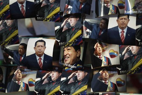Photos of the late President Hugo Chavez are hung out for sale outside of the Military Academy, where the funeral service of Chavez is being