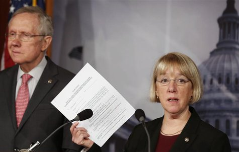 Senate Budget Committee chair Senator Patty Murray holds up a copy of a federal employees' Worker Adjustment and Retraining Notification (WA