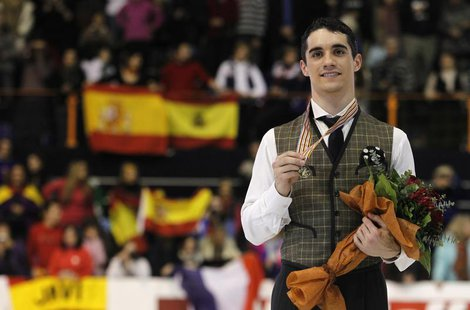 Gold medallist Javier Fernandez of Spain poses during the award ceremony for the men's skating at the European Figure Skating Championships