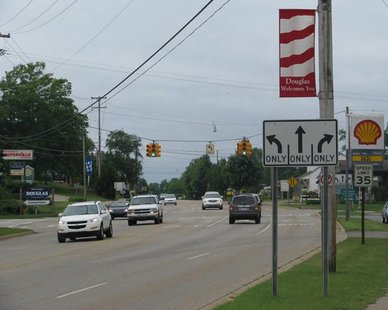 A VANISHING IMAGE? Traffic on Blue Star Highway at Wiley Road in Douglas. City planners are hoping to replace the traffic signal with a roundabout. (photo courtesy City of the Village of Douglas)