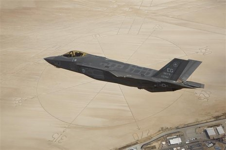 The second production model F-35A Lightning II aircraft flies above the compass rose of Rogers Dry Lakebed at Edwards Air Force Base, Califo