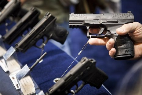 A Walther handgun is displayed at the Smith & Wesson booth at the Safari Club International Convention in Reno, Nevada, January 29, 2011. RE