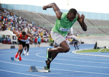 Jamaican runner Usain Bolt starts in the men's 400m race of the Camperdown Classic, an annual track event in its ninth year, in Kingston Feb