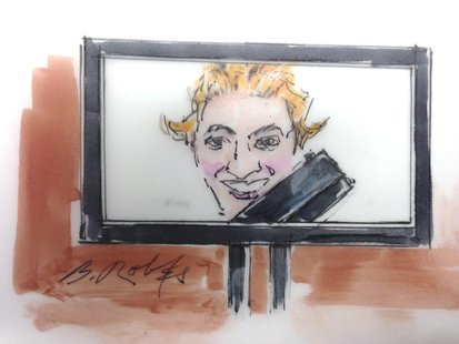 A picture of Colorado shooting suspect James Holmes is shown in courtroom sketch from a preliminary hearing in Centennial, Colorado January