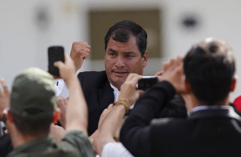 Ecuador's President Rafael Correa leaves the funeral ceremony for Venezuela's late President Hugo Chavez, at the Military Academy in Caracas